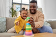 Leinwandbild Motiv family, parenthood and people concept - happy african american father and baby daughter playing with toy blocks at home