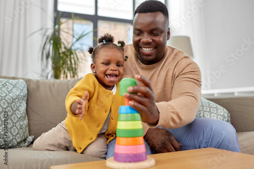 family, parenthood and people concept - happy african american father and baby d Canvas-taulu
