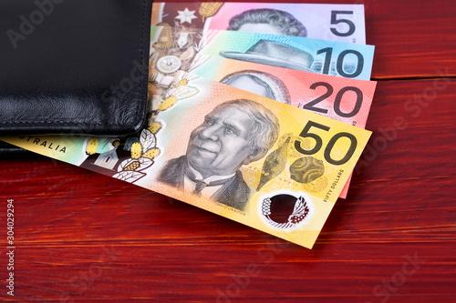 Fototapeta  New series of Australian dollars in the black wallet