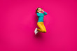 Leinwanddruck Bild - Full length body size photo of cheerful positive curly white nice cute pretty girlfriend jumping up listening to music isolated pink vibrant color background