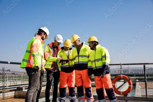 Valokuvatapetti Engineers and workers assesing wastewater plant