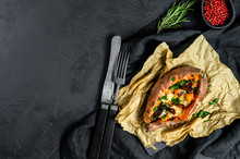 Baked Sweet Potato Stuffed With Cheese And Bacon. Black Background. Space For Text
