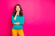 Leinwanddruck Bild - Photo of cheerful positive nice pretty cute curly wavy girlfriend wearing yellow pants trousers looking into empty space isolated vivid fuchsia color background