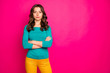 Leinwandbild Motiv Photo of candid serious confident youngster standing confidently with no emotions on face near empty space isolated fuchsia bright color background