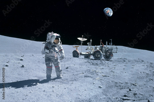 Astronaut near the moon rover on the moon Wallpaper Mural