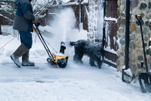 Man Clears Snow With A Snow Bl...