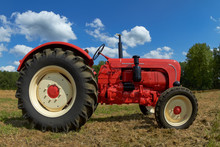 Red Vintage Tractor In The Meadow