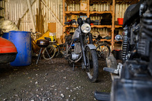 10.10.2019 Helsinki, Finland - Open Garage Space, With Vintage Motorcycle In Storage On Shelving.