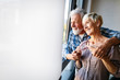 canvas print picture Happy romantic senior couple hugging and enjoying retirement at home