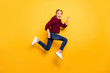 Full length body size view of her she nice attractive girlish comic cheerful cheery pre-teen girl jumping having fun time running isolated on bright vivid shine vibrant yellow color background