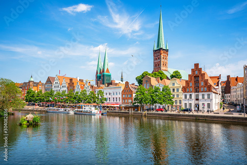 Leinwand Poster Classic panoramic view of historic skyline of hanseatic town of Lübeck with famous St
