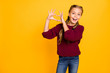 Leinwandbild Motiv Portrait of her she nice attractive lovely charming cute kind cheerful cheery careful pre-teen girl showing heart gesture isolated over bright vivid shine vibrant yellow color background