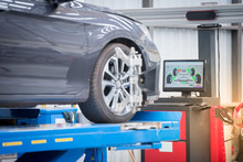 Car Mechanic Installing Sensor...