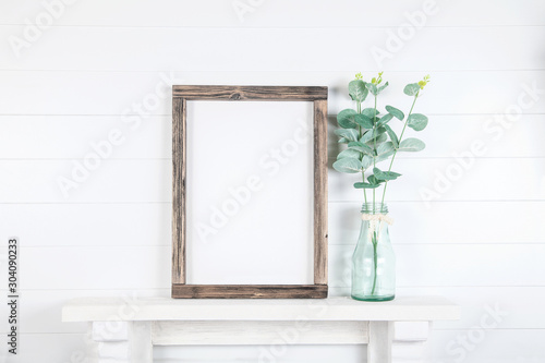 Fényképezés Mockup of a rough wooden frame on a white wall background in the interior