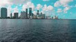 tilt-up drone shot flying towards Miami skyline over the water