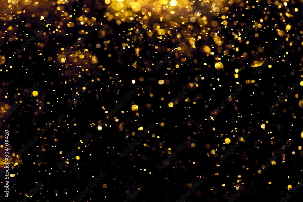 Fototapeta golden glitter bokeh lighting texture Blurred abstract background for birthday, anniversary, wedding, new year eve or Christmas