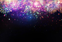 Beautiful Fireworks And Glitter Bokeh Lighting Effect Colorfull Blurred Abstract Background For Anniversary, New Year Eve Or Christmas
