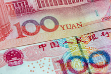 Close Up On China Yuan Money Bills With Front And Back Side