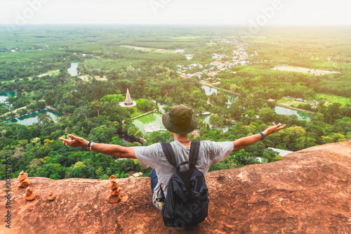 Fotografie, Tablou Man traveler on top of hill look joy fun view countryside scenic landscape Phu T