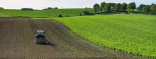 Tractor With Harrow On Field I...