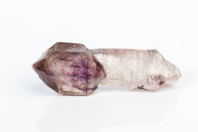 Macro Mineral Stone Amethyst On Smoky Quartz On A White Background