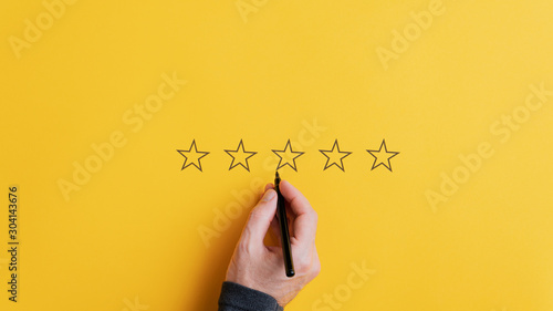 Obraz Male hand drawing five stars in a row - fototapety do salonu