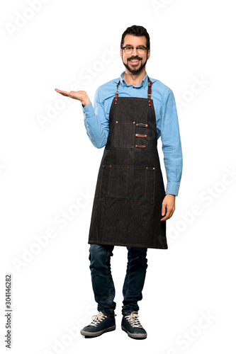 Full-length shot of Man with apron holding copyspace imaginary on the palm to in Poster Mural XXL