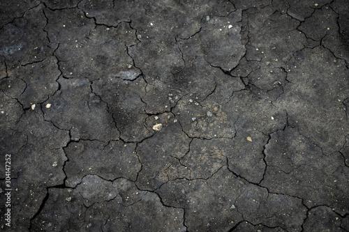 Fotografía  Black cracked surface top view