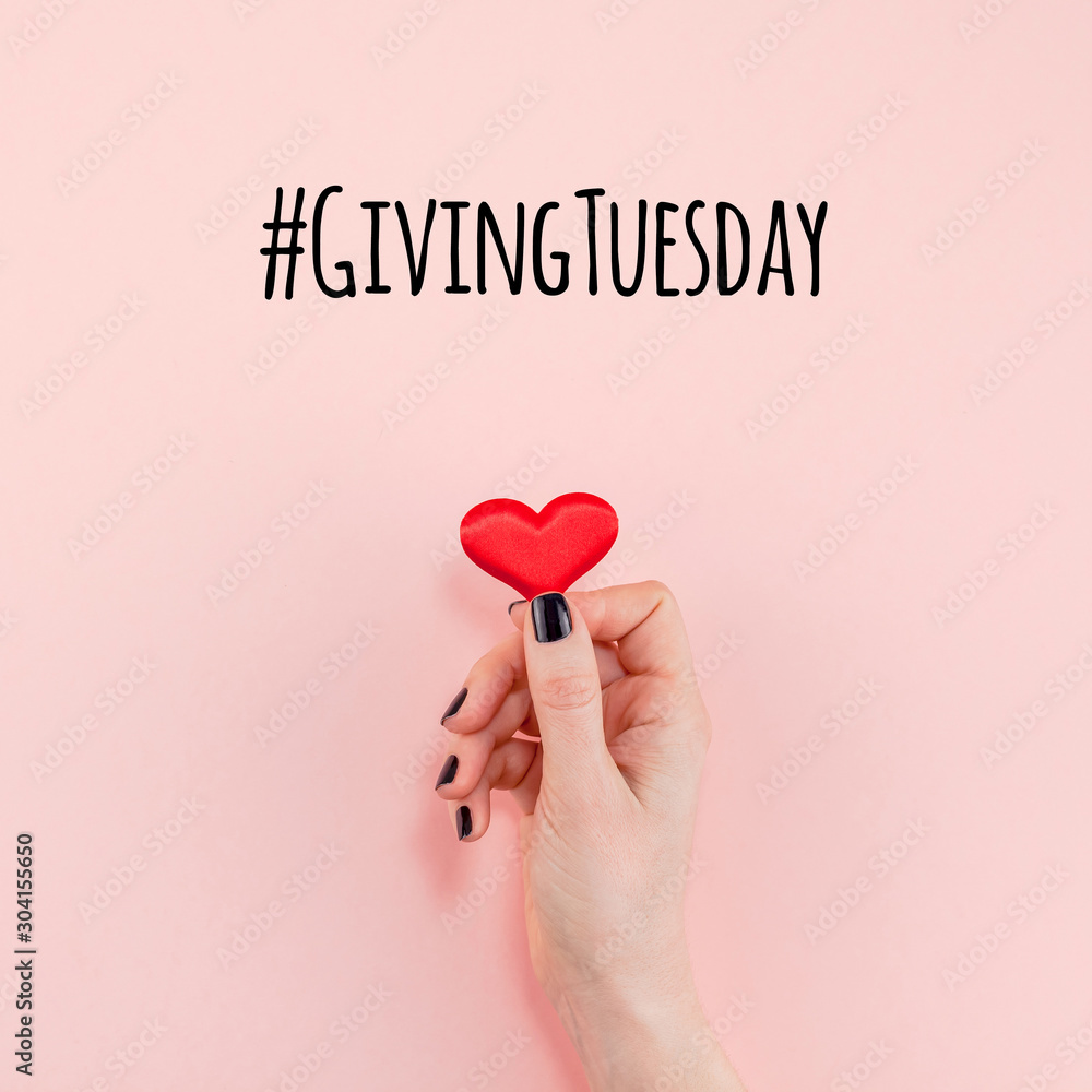Fototapeta Giving Tuesday concept with red heart in hand