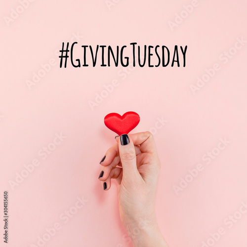Cuadros en Lienzo  Giving Tuesday concept with red heart in hand
