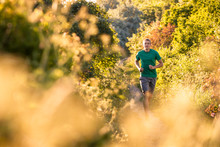 A Young Sportive Man Running S...