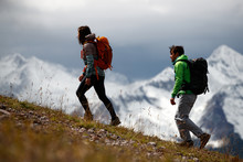 Side View Of Man And Woman Hiking On San Juan Mountains