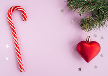 Christmas Composition With Heart, Fir Tree, Stars And Candy Cane On Pink Background. Flat Lay, Top View, Copy Space.