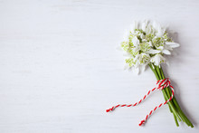 Bouquet Of Snowdrops On A Wooden Background For Congratulations