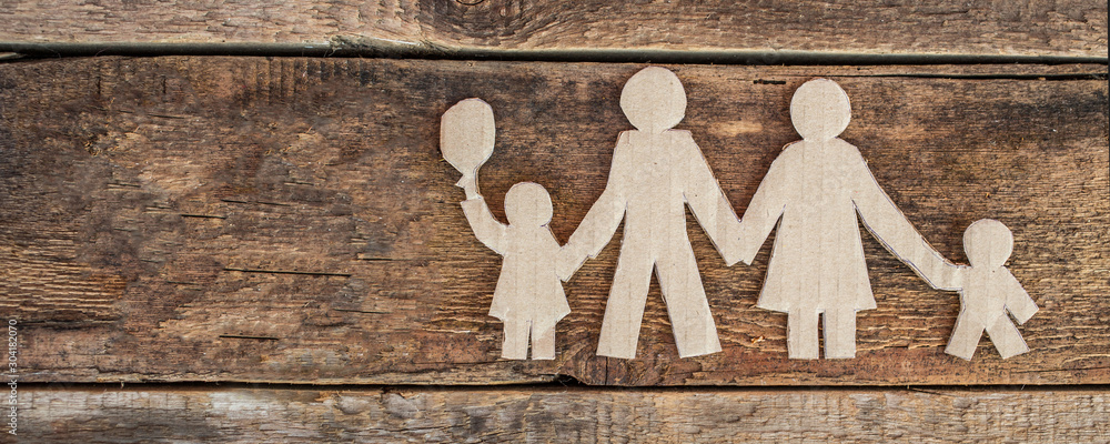Fototapety, obrazy: Family with two children, paper figures on wooden background