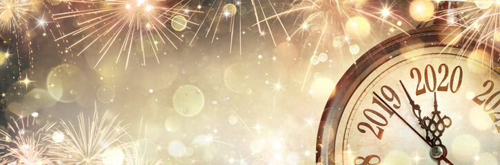 Fototapeta na wymiar New Year 2020 - Midnight With Clock And Fireworks