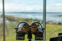 Binoculars Looking Out From An Observation Area