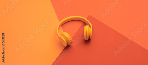 Minimal fashion, Trendy coral neon headphones. Music vibration on geometry background. Hipster DJ accessory Flat lay. Art creative summer vibes, fashionable pop art style. Bright neon color, banner - 304189217