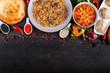 The concept of Eastern asian festive cuisine. Assorted Uzbek food set, pilaf, samsa, lagman, manta, shurpa restaurant concept, Uzbek food. Homemade Eastern arabic new year and Christmas dish from lamb