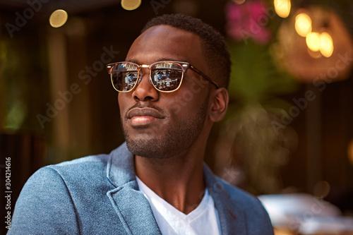 Fototapeta Portrait of young confident american businessman in sunglasses and blue blazer