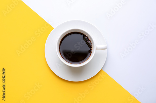 Photo Cup of hot coffee on color background