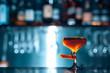 glass of fresh orange cocktail on blue background