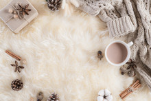 Autumn Or Winter Composition. Gift Box Coffee Cup, Cinnamon Sticks, Anise Stars, Beige Sweater With Knitted Blanket On Cream Color Gray Fluffy Background. Flat Lay Top View Copy Space.