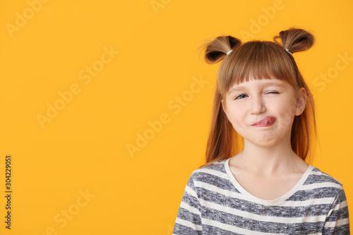 Cute little girl on color background Fototapeta