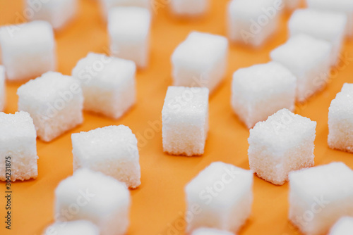 Fototapeta Cubes of sugar. Background of sugar cubes obraz