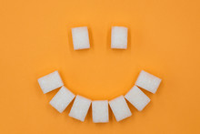 Smile Symbol, Composed Of Cubes Of Sugar. Concept Of Sugar Leading To Caries