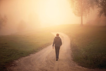 Man Walking Alone On Morning R...