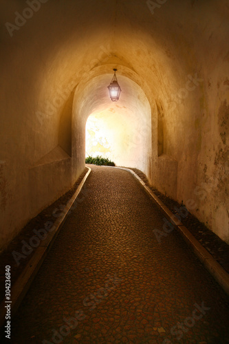 alley with light in castle in Lisabon, Portugal Wallpaper Mural