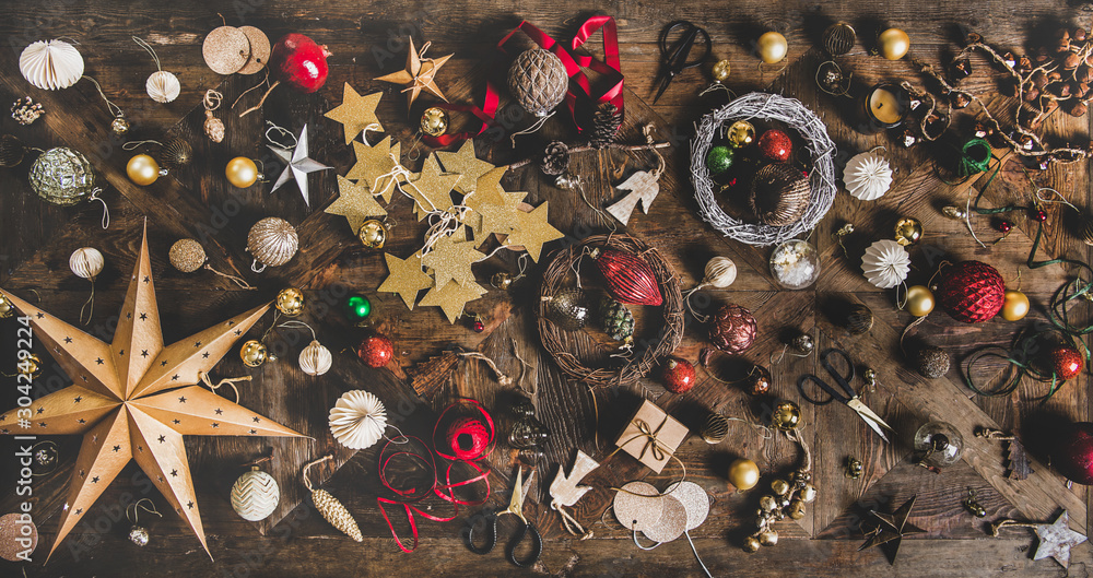 Fototapety, obrazy: Christmas, New Year holiday layout background, texture, wallpaper. Flat-lay of decorative objects, fur tree toys, garlands, ropes, wreaths over wooden background, top view. Winter holidays preparation