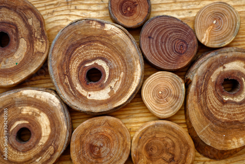 Fotobehang Brandhout textuur wooden background with a round slices of cherry, apple tree, plum-tree and ash lumber